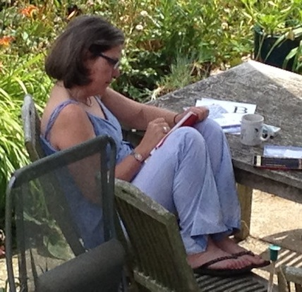 Lori (the artist) sketching in the garden