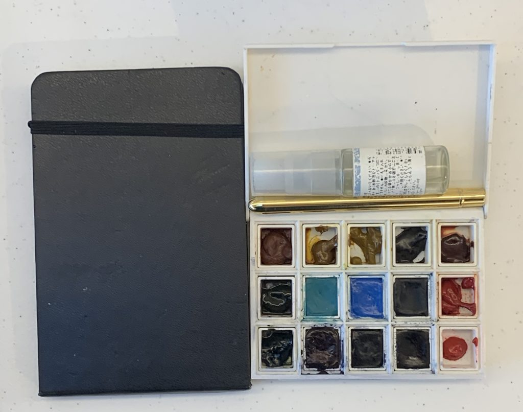 My new watercolour travel kit: Daniel Smith half pan set, moleskine A6 watercolour sketch book, travel brush and small water spray bottle.