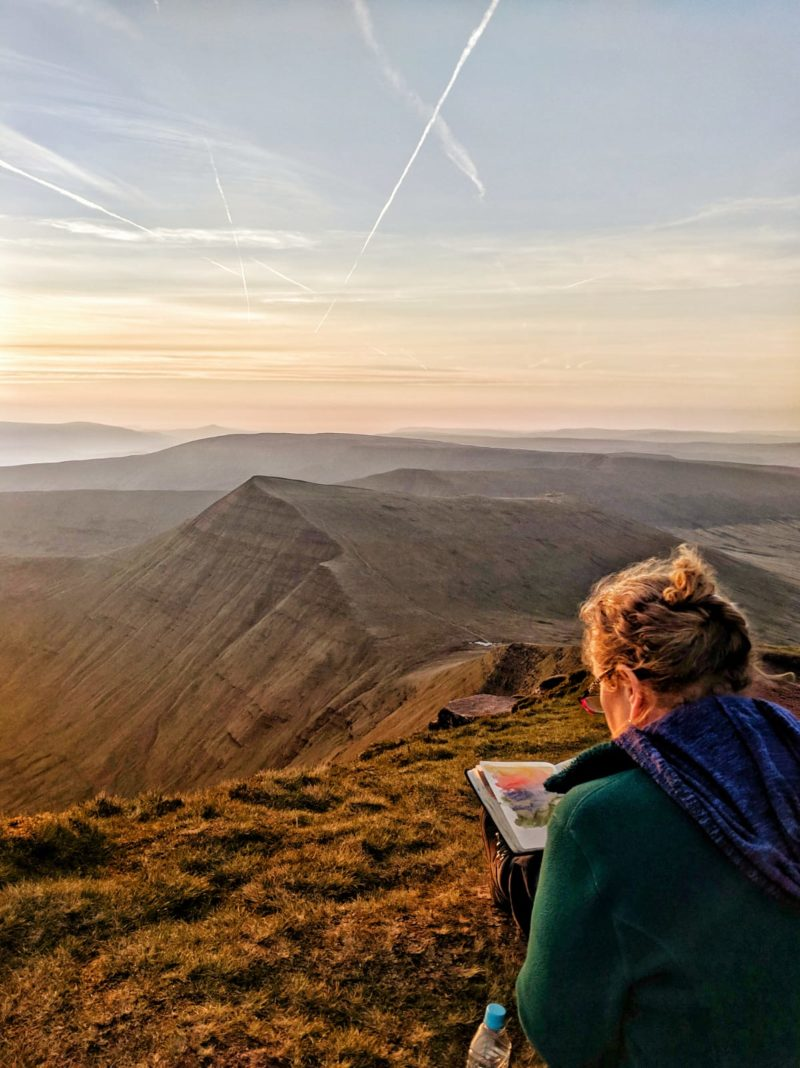 Watercolour painting the view from Pen y Fan at sunrise